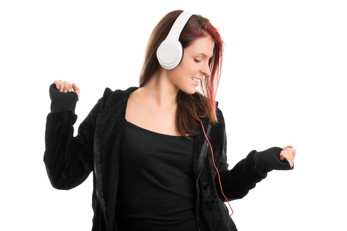 Young girl in a hooded sweatshirt dancing her favorite song
