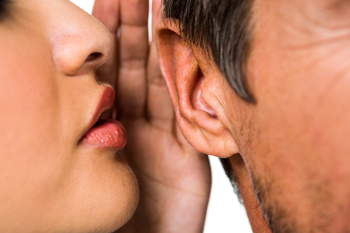 Woman whispering in man ear